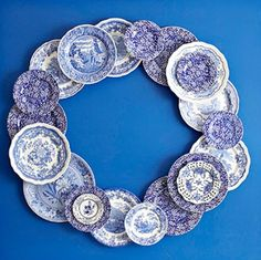 A collection of blue and white plates has been turned into a wreath that can be leaned against the wall on a mantel. arrange plates on a square of plywood that's been spray-painted a coordinating color. White Dishes, White Plates, Blue Plates, Orange Plates, Blue Dishes, Blue And White China, Blue China, Love Blue, Hanging Plates