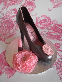 Chocolate candy shoe with edible lipstick and rose decorations by Sweetpea cakes and Treats, via Flickr