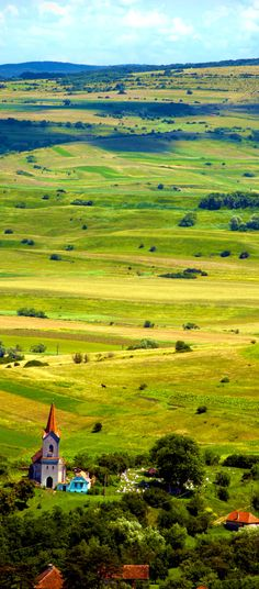 Beautiful Plateau Landscape and Village with Church in Transylvania Romania - Hasag        Discover Amazing Romania through 44 Spectacular Photos