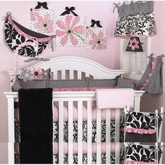 Decorate your babys entire crib with this 8-piece baby girl crib bedding set featuring an adorable pink, black, and white coordinating print. Polka dots, floral prints, and ruffles adorn this beautiful set. These bedding items are machine washable.