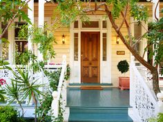 I love the greenery surrounding this verandah; love the blue deck!
