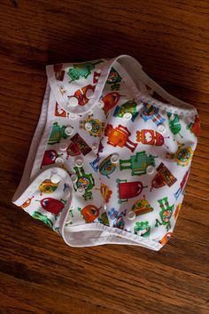 Diaper Cover with Gussets Tutorial (finally!!!) | Crazy Wonderful Life ((Could even put some plastic-type lining in it and use cloth diapers and have this as the outer cover....or just use over disposible ones to cute them up! OH! And velcro works wonders instead of snaps if you want))