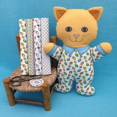 """Cat in Pajamas"" is a Cut and Sew Softie fabric panel. DIY. The fabrics on the chair are also available in my Spoonflower shop. Link in Profile."