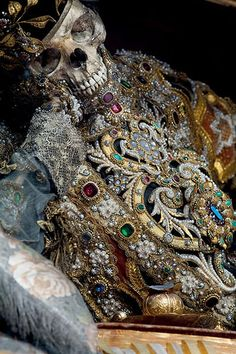 St Valentinus in Waldsassen, Germany, was decorated by the lay brother Adalbart Eder, and wears a biretta and an elaborate, jewelled version of a deacon's cassock, as the saint was believed to have been a deacon