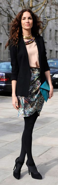 I like the shape of this skirt with the tights, the use of color with black. If it were a cardigan rather than a blazer, I think it could be something Stacey wears to work.