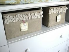 cover random boxes with burlap, add ruffle embellishment. cuteness!