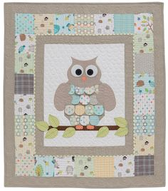 Adorable owl quilt for Baby that's charm-square friendly! Find the pattern in the book Sew Sweet Baby Quilts by Kristin Roylance.