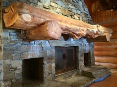 Massive stone fireplace and wood mantel made out of western red ...