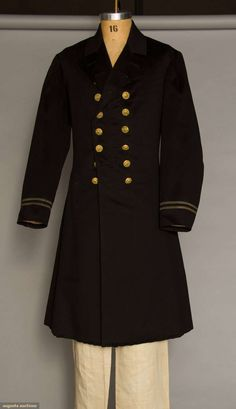 """MAN'S BLACK NAVAL FROCK COAT, c. 1862 Wool broad cloth, narrow metallic stripes on cuffs, single notched collar, 9 pair double breasted front buttons, 2 buttons above & 2 at hem of CB skirt split, low waist seam front to back, buttons w/ eagles perched on anchor in gold repouse w/ silvermetal back & attached shank, printing illegible, black cotton lining quilted above skirt, 1 breast pocket, CH 38"""", L 40"""", (1 moth hole on skirt near seam .25""""x.33"""") otherwise excellent. BROOKLYN MUSEUM"""