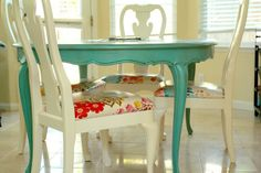 Dining Room Idea- really like the aqua table with white chair and red accent on the cover.