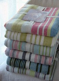 "Striped Cotton Throws  Get cozy with a new book and colorful throw. These hand loomed, flat weave Striped Cotton Throws come in a variety of color combinations. These 100% cotton throws are practically a necessity during the spring and summer. Machine wash cold. Tumble dry low. Do not bleach.     60"" W x 78"" L"
