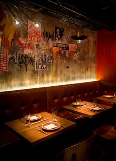 Fatty Crab, Hong Kong...uplighting behind banquette-sweet! the graffiti collage wall is tasty too