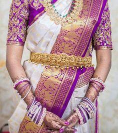 South Indian bride. Gold Indian bridal jewelry.Temple jewelry. Jhumkis.Purple and white silk kanchipuram sari.Braid with fresh jasmine flowers. Tamil bride. Telugu bride. Kannada bride. Hindu bride. Malayalee bride.Kerala bride.South Indian wedding.