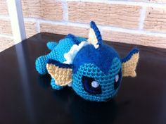 Pokemon Vaporeon plushie (with free crochet pattern): to get pattern it will either automatically show up, or you would have to press the i button. Furthermore, she also offers many other free patterns for you to use. Pokemon Crochet Pattern, Crochet Geek, Amigurumi Patterns, Cute Crochet, Crochet Crafts, Crochet Dolls, Yarn Crafts, Knitting Patterns, Crochet Patterns