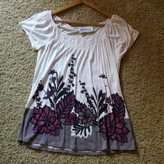 Flower baby doll top An adorable baby doll top from B. Moss! Never worn but had the tags taken off. Has a scoop neckline and is in excellent condition! Features a purple flower pattern all over the shirt and is very light and comfortable! B. Moss Tops