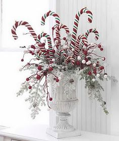 Check out this collection of 36 Impressive Christmas Table Centerpieces and find how to decorate your holiday table. Tie red-and-white peppermint sticks around a vase with a.use candy canes in centerpiece. great idea for the kids table at Christmas d Noel Christmas, Christmas Projects, All Things Christmas, Winter Christmas, Christmas Wreaths, Christmas Ornaments, Whimsical Christmas, Beautiful Christmas, Outdoor Christmas