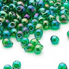 Seed bead, Miyuki, glass, transparent rainbow green, (DP179), 4x3.4mm fringe. Sold per 250-gram pkg.