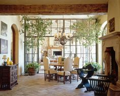Yes the trees are figs. The floor is antique Parfieulle tiles and the fireplace is carved travertine from Unique Stone Imports in San Diego. The iron doors are from a San Diego iron fabricator.""
