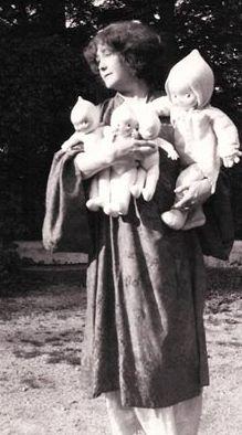 Rose O'Neill holding Kewpie Dolls