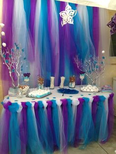 Purple, white, blue, and teal dessert table decoration idea for a winter wonderland or Frozen theme birthday party including silver painted branches and affordable toule DIY backdrop. Frozen Themed Birthday Party, Disney Frozen Birthday, 4th Birthday Parties, Frozen Party, Birthday Party Decorations, Frozen Table Decorations, Frozen Candy Table, Birthday Candy, 3rd Birthday