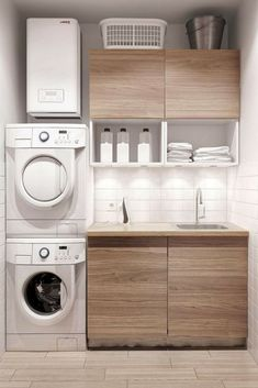 Laundry rooms can double as mini-warehouses if you include storage in it, like cabinets and shelves. [Laundry Room Ideas, Small Laundry Room Storage, Small Laundry Room Ideas, Laundry Room Storage, Laundry Room Organization, Laundry Room Cabinets, Wood Cabinets, Tile Backsplash]