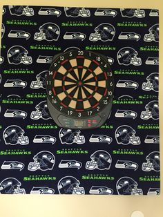 Seahawks fleece over styrofoam to protect our wall for the dart board