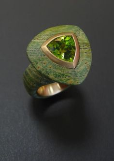wood burl ring with metal inner ring and peridot  Christoph Deisberg