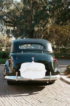 Getaway car with die cut just married sign by Lettered Olive (www.letteredolive.com) #plantationwedding #georgiawedding #fordplantationwedding #adriennepagephotography #southernwedding #blueandwhitetoile #taraguerard #taraguerarddecor #taraguerardsoiree
