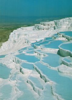 "Turkey - Pammukale. It means ""cotton castle"". That water is amazing!"