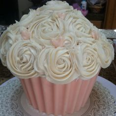 Large cupcake my Mother made for my sons wedding! The bottom is white chocolate and the roses on top is frosting! Turned out beautiful!