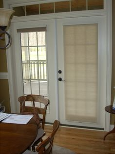 cell shades on french doors. This is what it would look like open and closed...