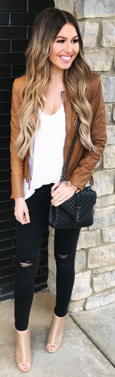 Tan leather jacket over white tee and black jeans.