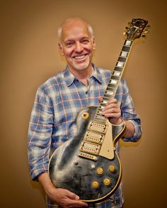 Peter Frampton holding his '54 Gibson Les Paul that was presumed destroyed in a plane crash. He gets it back after 30 years.