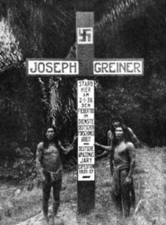 Brazilian natives at a Nazi grave decorated with swastikas , 1937
