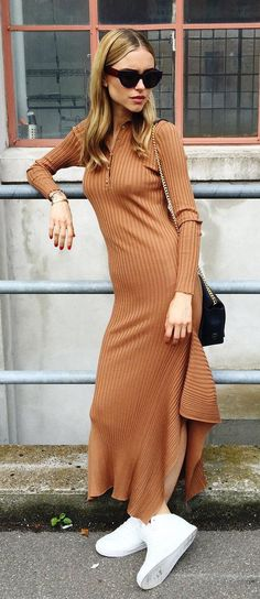 Pernille Teisbaek steps out in a Stella McCartney knit dress, H&M sneakers, Leowulff bag, and Céline sunglasses #sportymeetscoolstyle