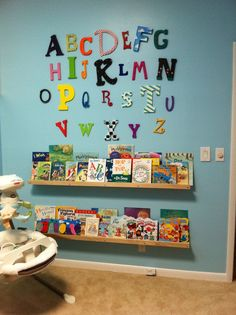 Baby boy nursery... Alphabet and book shelves! Hand painted letters and hand made shelves! Above the reading nook