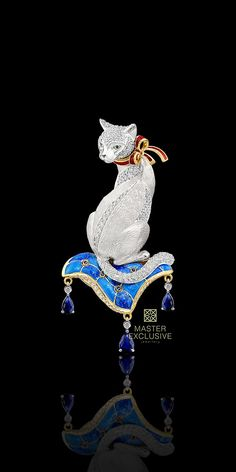 Cat brooch, with Ruby bow and sitting on enamel pillow