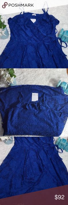 """Love Fire Lace Dress Blue Faux Wrap Blue lace dress with a faux wrap in the front and a side zipper.  NWT. Measurement approximations: waist across 14"""" and length 31"""". The shell is 90% and 10% Spandex. Love Fire Dresses"""