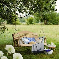 I want a big swing seat but I want it against my house on the porch