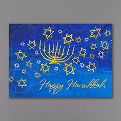 Menorah and Stars Holiday Card  Stars of David surrounding a golden Menorah along with a wish for a Happy Hanukkah seemingly dance across the front of this card. Now 30% off at www.invitationsforless.com