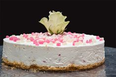 For a special occasion, give the basic lemon cheesecake an exotic flavour with rosewater and chopped up Turkish delight. Top with whipped cream and fresh rosebuds.