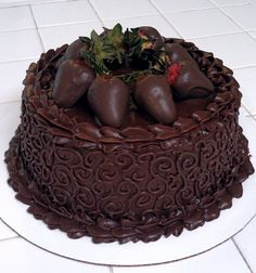 Chocolate covered strawberries and chocolate cake.
