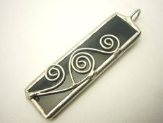 Check out this item in my Etsy shop https://www.etsy.com/sg-en/listing/202517107/black-stained-glass-contempory-jewelry