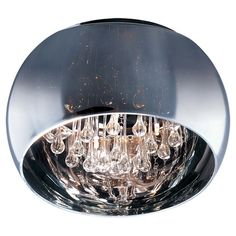Showcasing crystal teardrop accents and a polished chrome shade, this flush mount illuminates your den or master suite in standout style.   ...