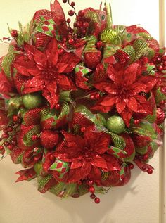 Christmas Deco Mesh Wreath with Red Glitter Poinsettias and Berries https://www.facebook.com/pages/Kattfish-Kreations/659509324079375