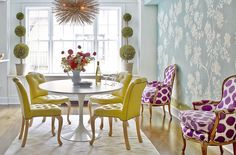Duck egg blue, white, soft buttery yellow, purple, green, and gold in this colorful yet soft neo-trad dining room.