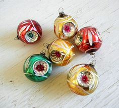 Six elegant + vintage glass Christmas tree ornaments. All of them have triple indents and hand-painted details.