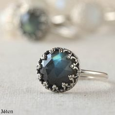 Cocktail Ring, Solitaire Ring. A very flashy and beautiful rose cut labradorite is set in a princess crown setting. The band is substantial smooth round