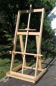 Build Your Own Easel! -- do you think we could get dzai dzu (however we spell his name) to build two of them?? :)