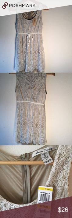 American Rag Cream & Tan Lace Dress New With Tag This lacy sleeveless dress has cream ribbon at the waist. Perfect for dinner or special occasion. New American Rag Dresses